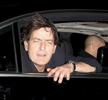 Sheen Hanging Out of Limo