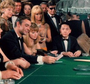 Bond Smiling with Cards